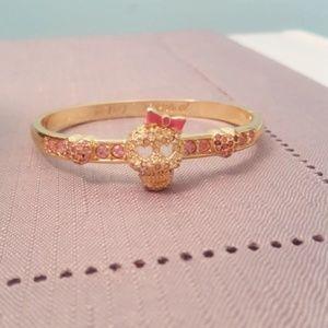 Betsy Johnson gold skull bracelet